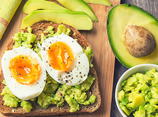 A soft-boiled egg on top of avocado toast