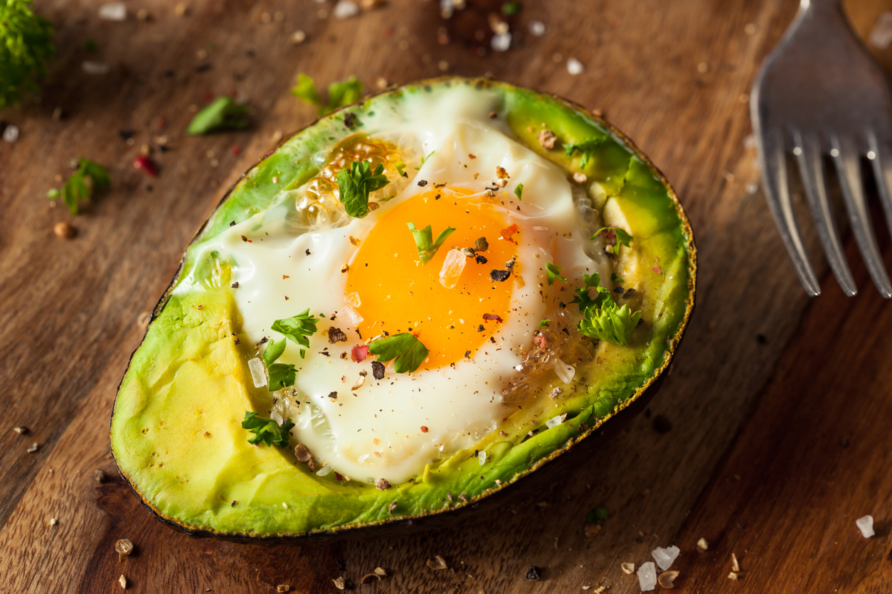 Organic Egg Baked in Avocado with Salt and Pepper