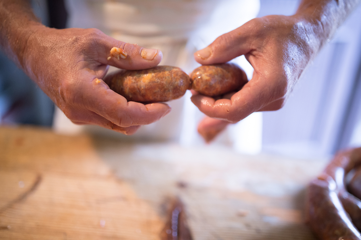 Man Making Sausages the Traditional Way