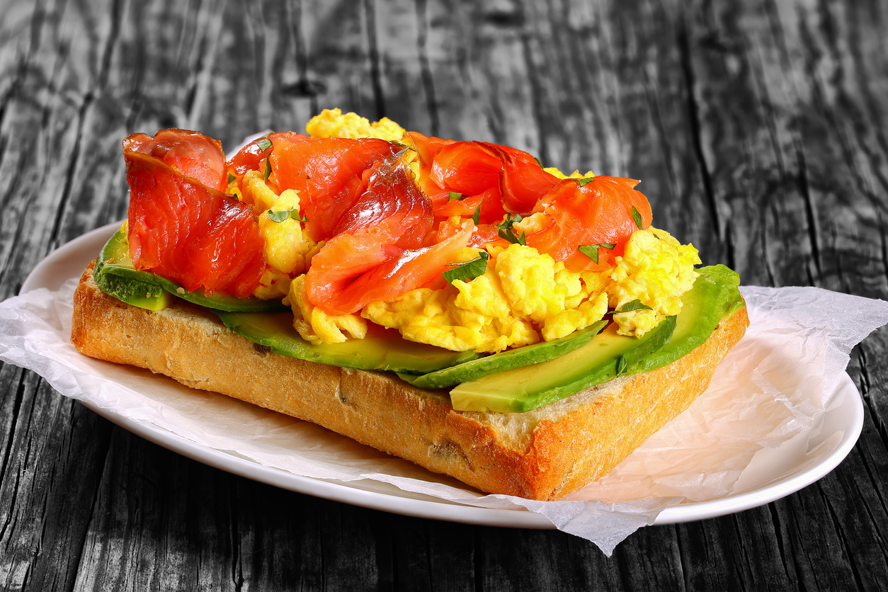 Salmon, Avocado, and Scrambled Egg Sandwich on Ciabatta Bread