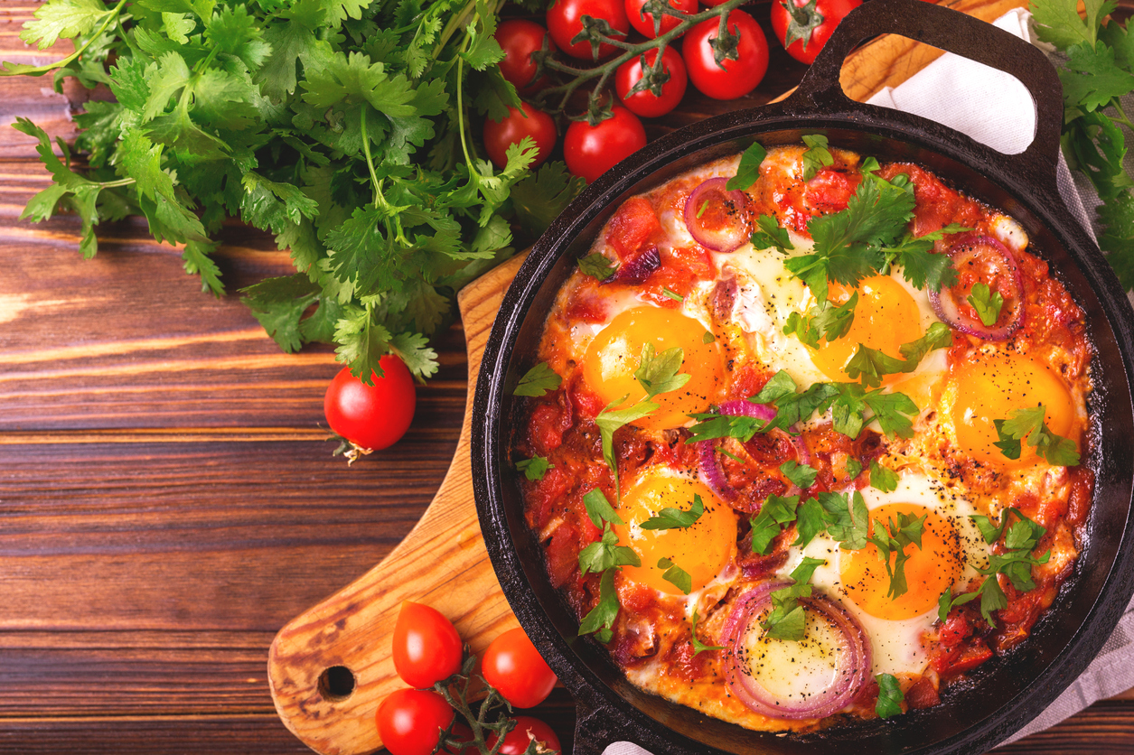 Shakshuka Israeli Breakfast or Lunch Cuisine - Fried Egg with Vegetables