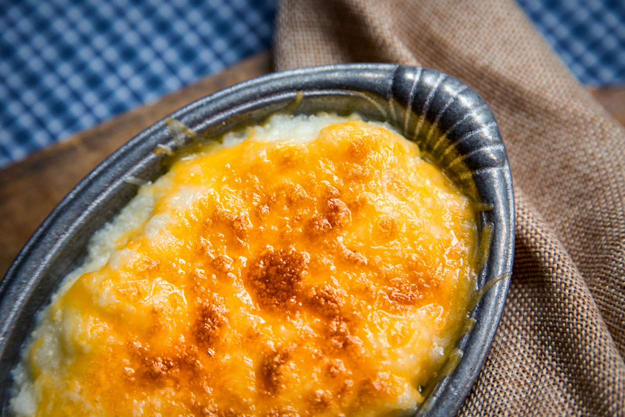 Pewter Bowl Topped with Baked Cheddar Cheese Grits