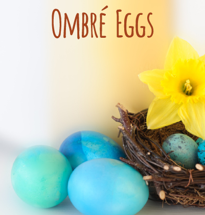 Blue ombre eggs next to a bird nest and a daffodil