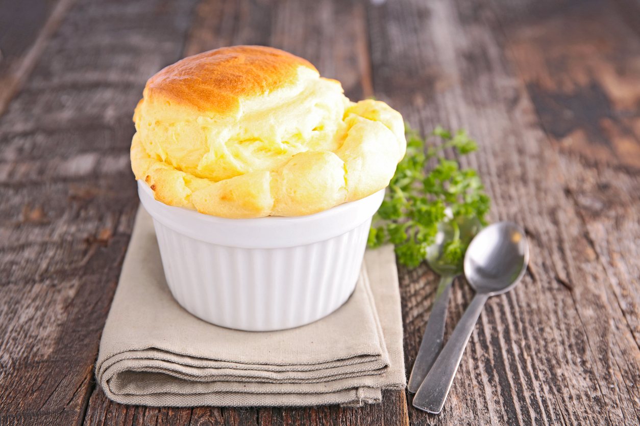classic cheese souffle in a small white dish