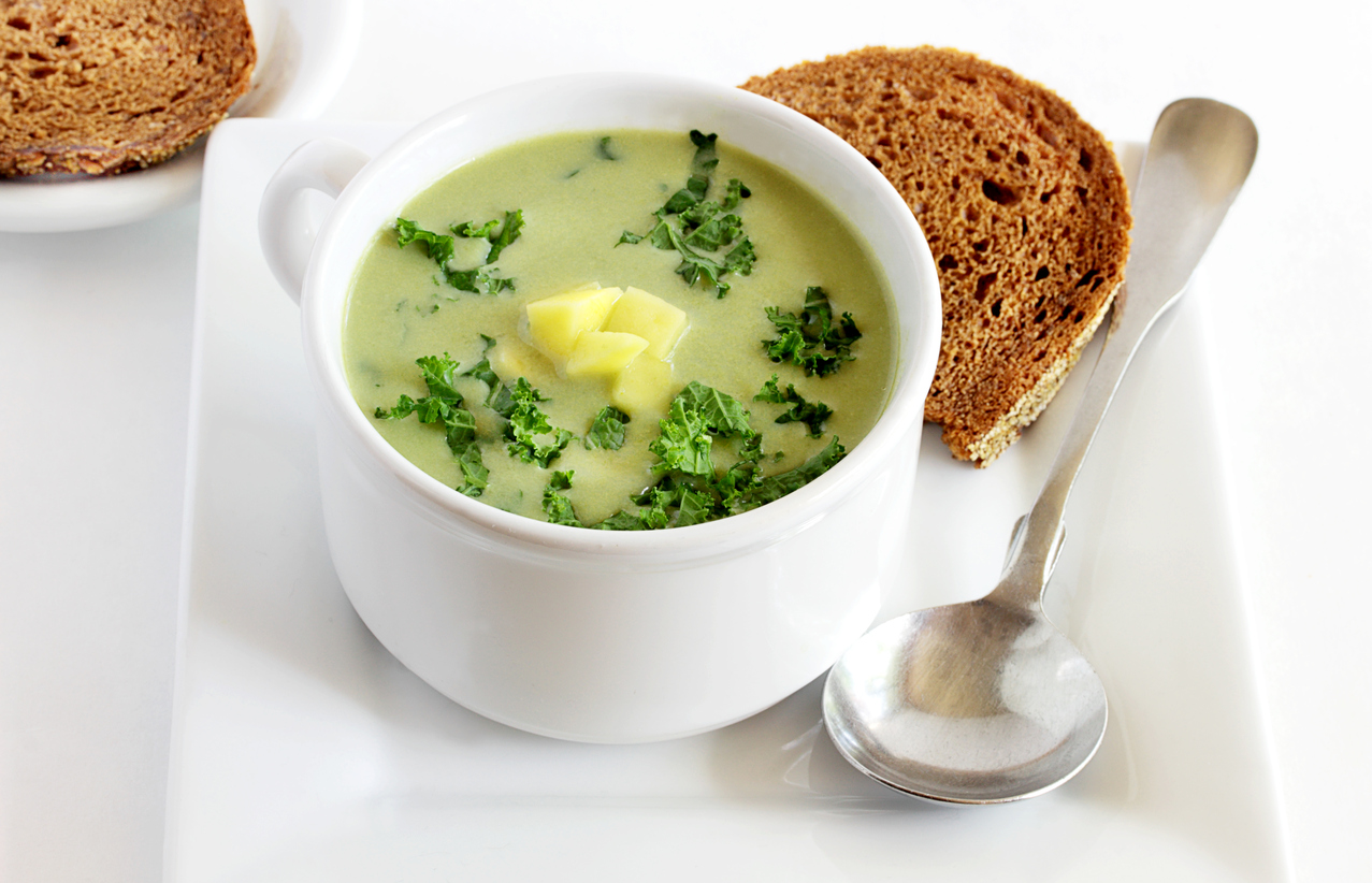 Cup of potato and kale soup