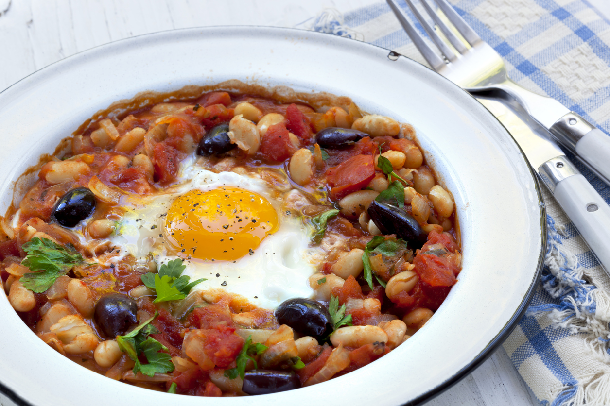 A bowl of chorizo, chickpea and baked egg stew