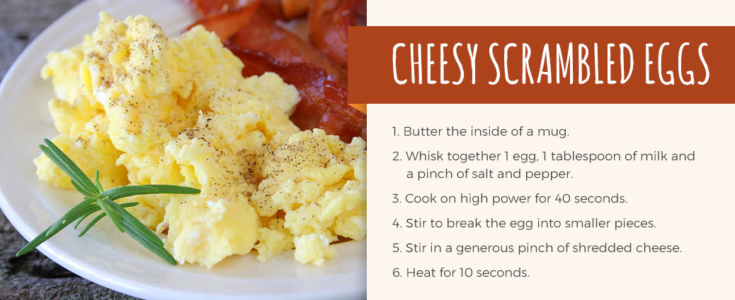 recipe for cheesy scrambled eggs: butter inside of mug, whisk together 1 egg, 1 tbsp of milk and pinch of salt and pepper, cook on high power for 40 seconds, stir to break up egg, stir in cheddar cheese, and heat for 10 seconds