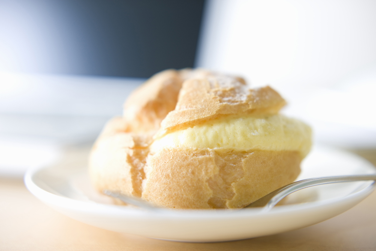vanilla stuffed cream puff on a small plate