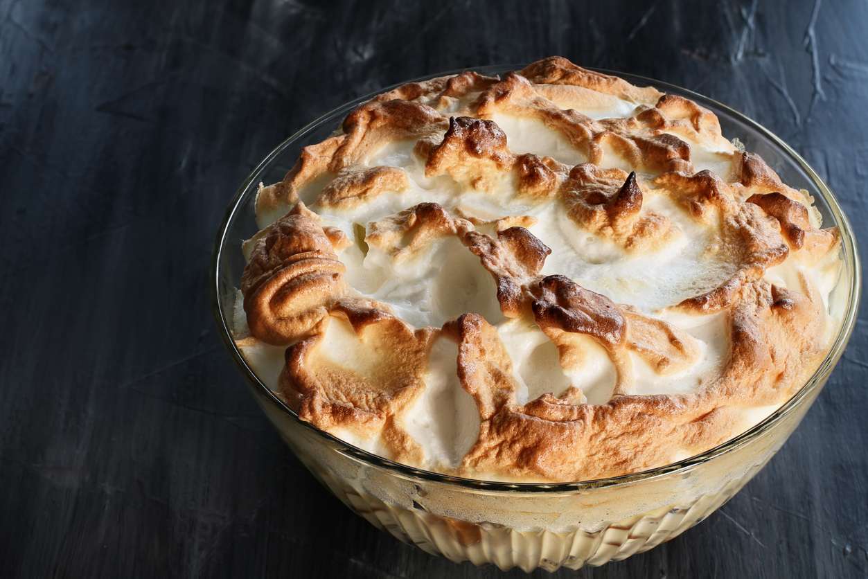 a bowl of homemade banana pudding with meringue topping