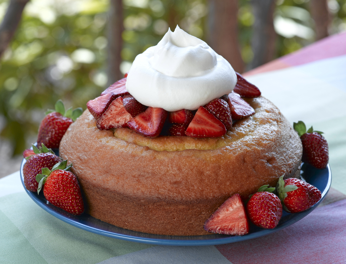 strawberry pound cake topped with strawberries